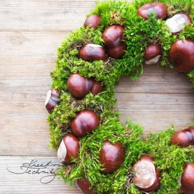 Autumn wreath of chestnuts and moss